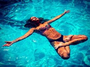 girl floating in pool