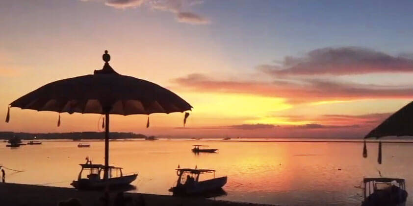 boats at sunset on nusa lembongan bali